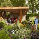Music was at the roots of this year's Morgan Stanley Garden at the RHS Chelsea Flower Show, designed by Chris Beardshaw, pictured here with the broadcaster Katie Derham (Morgan Stanley/John Campbell).